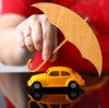 Male arm cover unrecognizable yellow toy car with umbrella closeup. Driver money loss prevention, parasol, secure road trip, drive idea, harmless gesture, owner protective offer