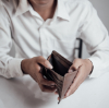 businessman saving money, Close up man carrying a wallet in hand, the dollar,finance accounting concept